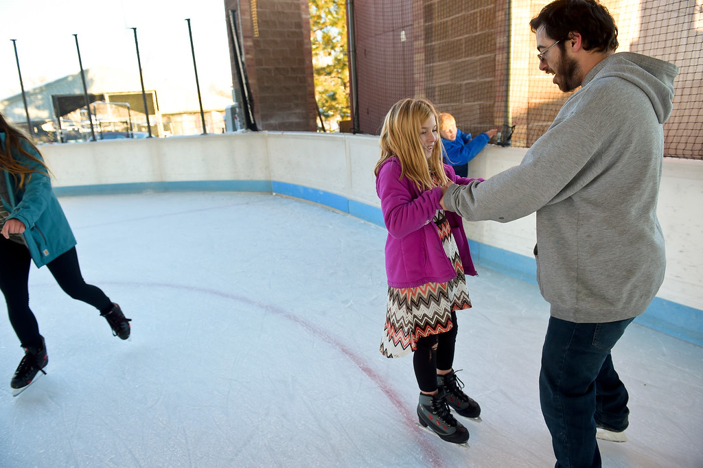 . LONGMONT, CO - NOVEMBER 12: Robert Casey helps his daughter Taylor Casey, 9, while skating at the Longmont Ice Pavilion in Roosevelt Park Nov. 12, 2018. Monday was the first day the skating rink was open for the season. (Photo by Lewis Geyer/Staff Photographer)