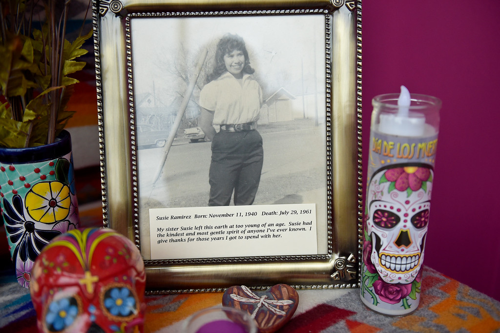 . LONGMONT, CO - OCTOBER 10: A photo of Susie Ramirez on an altar at the Día de los Muertos exhibition Oct. 10, 2018 at the Longmont Museum and Cultural Center. The annual exhibit runs through Nov. 6. (Photo by Lewis Geyer/Staff Photographer)