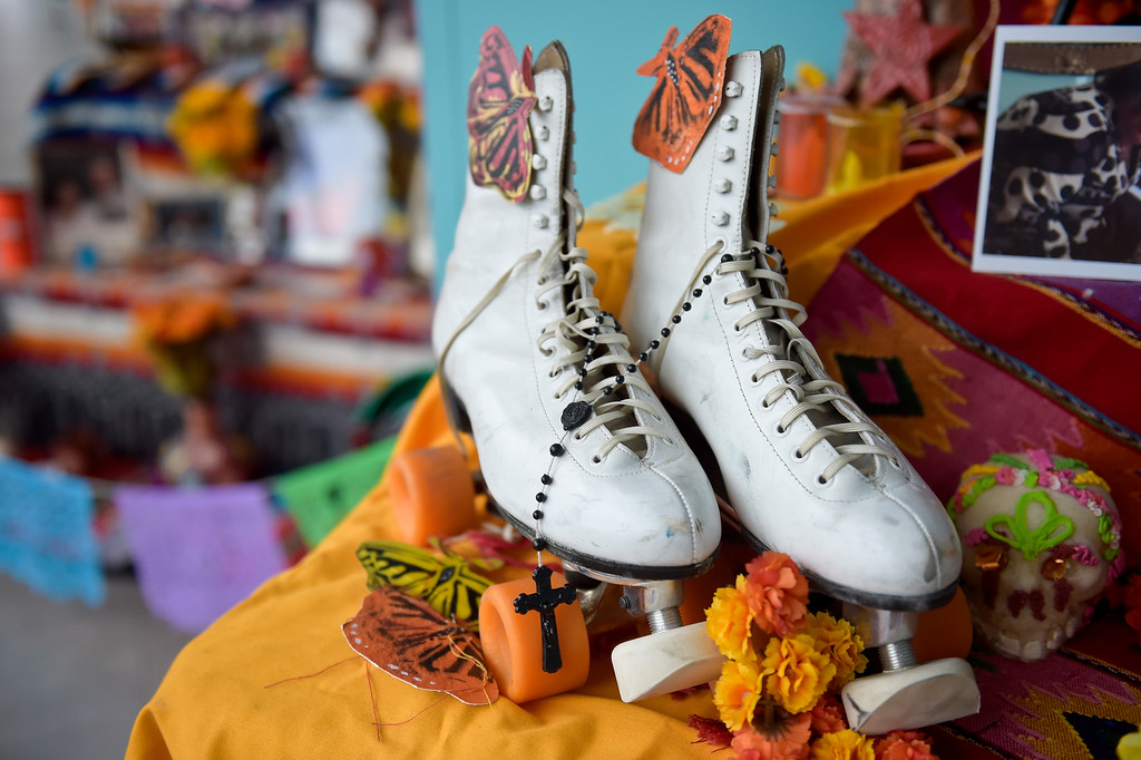 . LONGMONT, CO - OCTOBER 10: Roller skates are displayed on an altar at the Día de los Muertos exhibition Oct. 10, 2018 at the Longmont Museum and Cultural Center. The annual exhibit runs through Nov. 6. (Photo by Lewis Geyer/Staff Photographer)