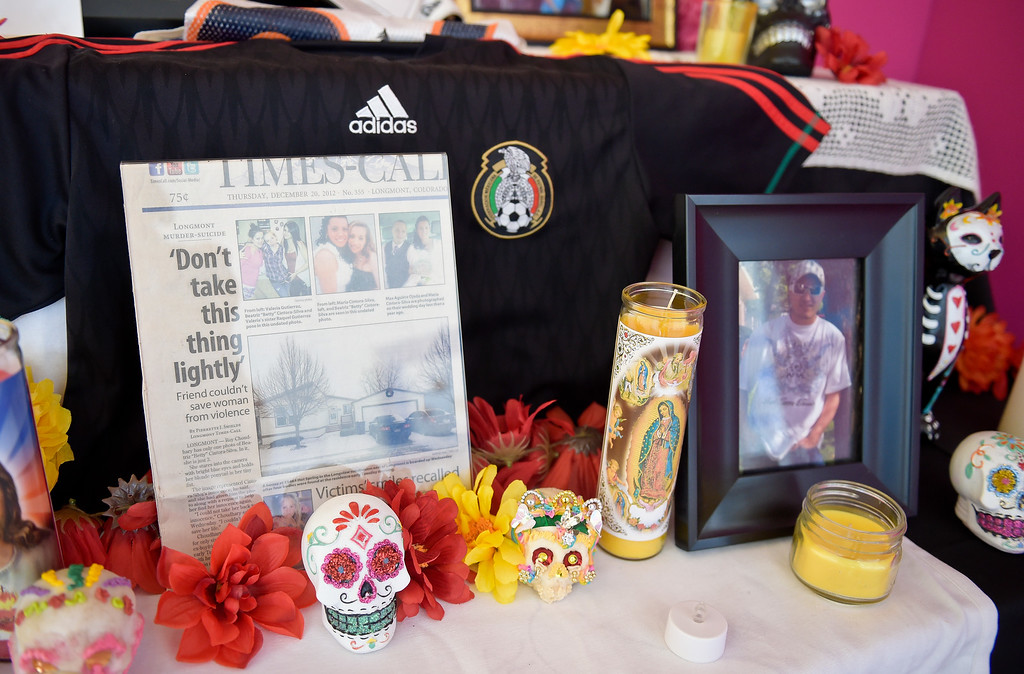. LONGMONT, CO - OCTOBER 10: A Times-Call article is displayed on an altar at the Día de los Muertos exhibition Oct. 10, 2018 at the Longmont Museum and Cultural Center. The annual exhibit runs through Nov. 6. (Photo by Lewis Geyer/Staff Photographer)