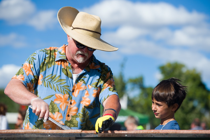 "Wally Clark and his stepson Zev Gatto, 8, help cook a 450-foot-long bratwurst during the annual Longmont Oktoberfest at Roosevelt Park on Saturday. <br /> More photos:  <a href=""http://www.dailycamera.com"">http://www.dailycamera.com</a><br /> (Autumn Parry/Staff Photographer)<br /> September 24, 2016"