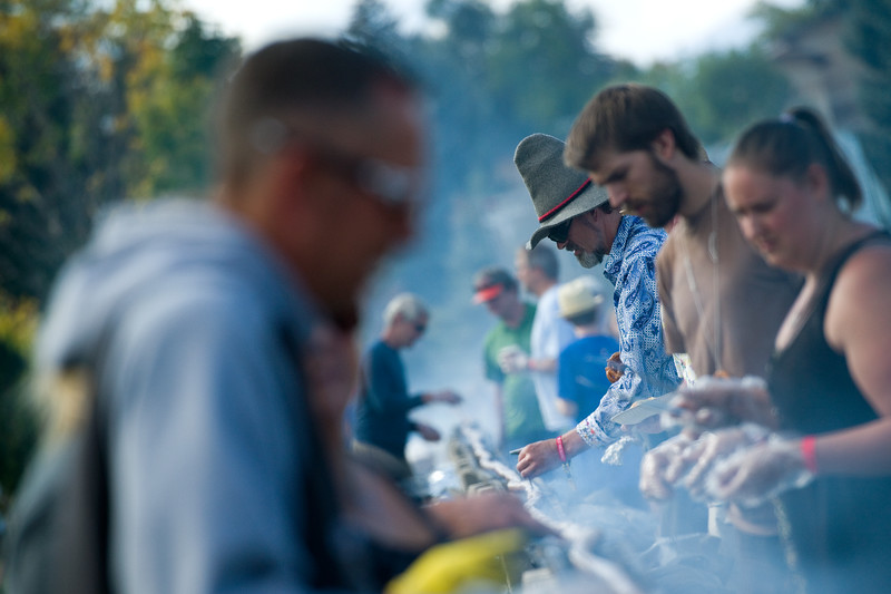 "President and Co-Founder of Left Hand Brewing Eric Wallace (center) checks the temperature of the 450-foot-long bratwurst to make sure it's fully cooked, during the annual Longmont Oktoberfest at Roosevelt Park on Saturday. <br /> More photos:  <a href=""http://www.dailycamera.com"">http://www.dailycamera.com</a><br /> (Autumn Parry/Staff Photographer)<br /> September 24, 2016"