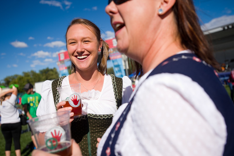 "Hannah Hudson (left) shares a laugh with Joan Bruemmer-Holden during the annual Oktoberfest at Roosevelt Park in Longmont on Saturday.<br /> More photos:  <a href=""http://www.dailycamera.com"">http://www.dailycamera.com</a><br /> (Autumn Parry/Staff Photographer)<br /> September 24, 2016"