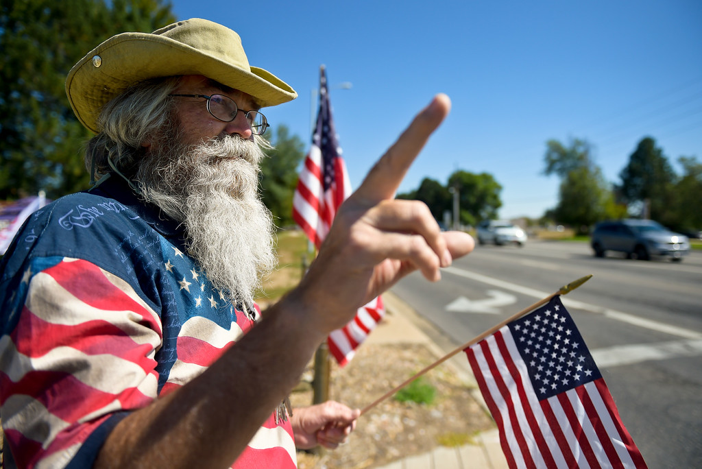 . LONGMONT, CO - SEPTEMBER 22, 2018: Chuck Goode, of Longmont, waves to passing cars at the �I Stand With Trump! � Make America Great Again �Get out the Vote� rally at the intersection of Nelson Road and Hover Street Sept. 22. (Photo by Lewis Geyer/Staff Photographer)