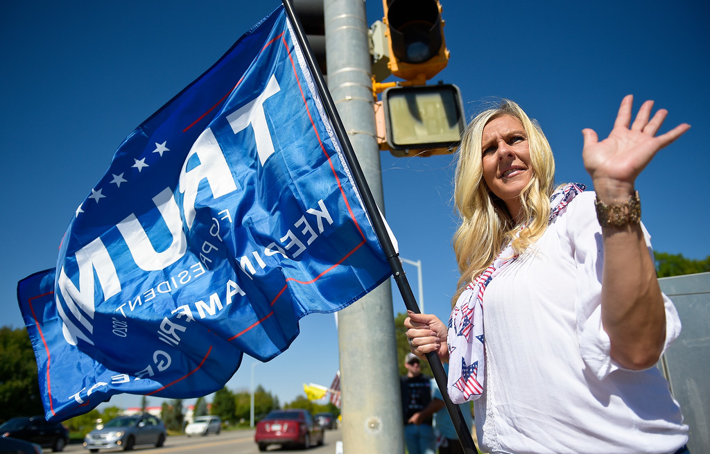 . Best LONGMONT, CO - SEPTEMBER 22, 2018: Amie Ingram, of Windsor, waves to passing vehicles at the �I Stand With Trump! � Make America Great Again �Get out the Vote� rally at the intersection of Nelson Road and Hover Street Sept. 22. (Photo by Lewis Geyer/Staff Photographer)