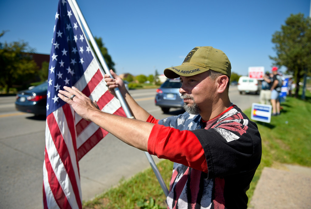 . LONGMONT, CO - SEPTEMBER 22, 2018: James Gonzales, of Longmont, waves to passing cars at the �I Stand With Trump! � Make America Great Again �Get out the Vote� rally at the intersection of Nelson Road and Hover Street Sept. 22. (Photo by Lewis Geyer/Staff Photographer)