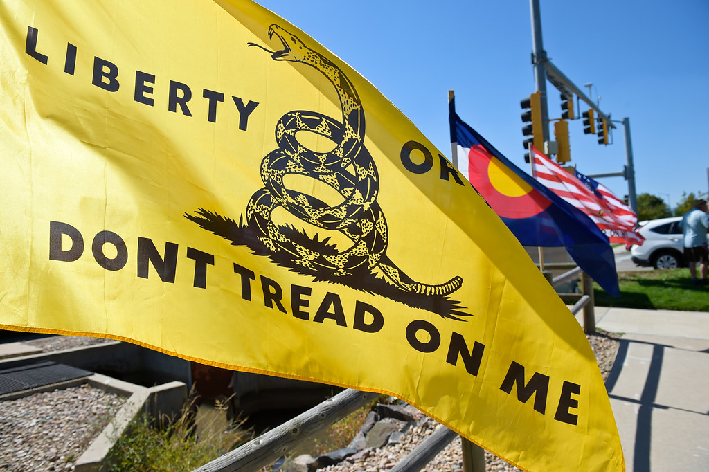 . LONGMONT, CO - SEPTEMBER 22, 2018: Flags line the sidewalk at the �I Stand With Trump! � Make America Great Again �Get out the Vote� rally at the intersection of Nelson Road and Hover Street Sept. 22. (Photo by Lewis Geyer/Staff Photographer)