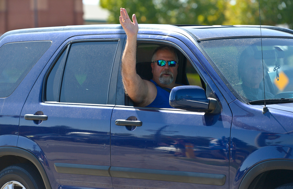 . LONGMONT, CO - SEPTEMBER 22, 2018: A passing motorist waves at the �I Stand With Trump! � Make America Great Again �Get out the Vote� rally at the intersection of Nelson Road and Hover Street Sept. 22. (Photo by Lewis Geyer/Staff Photographer)
