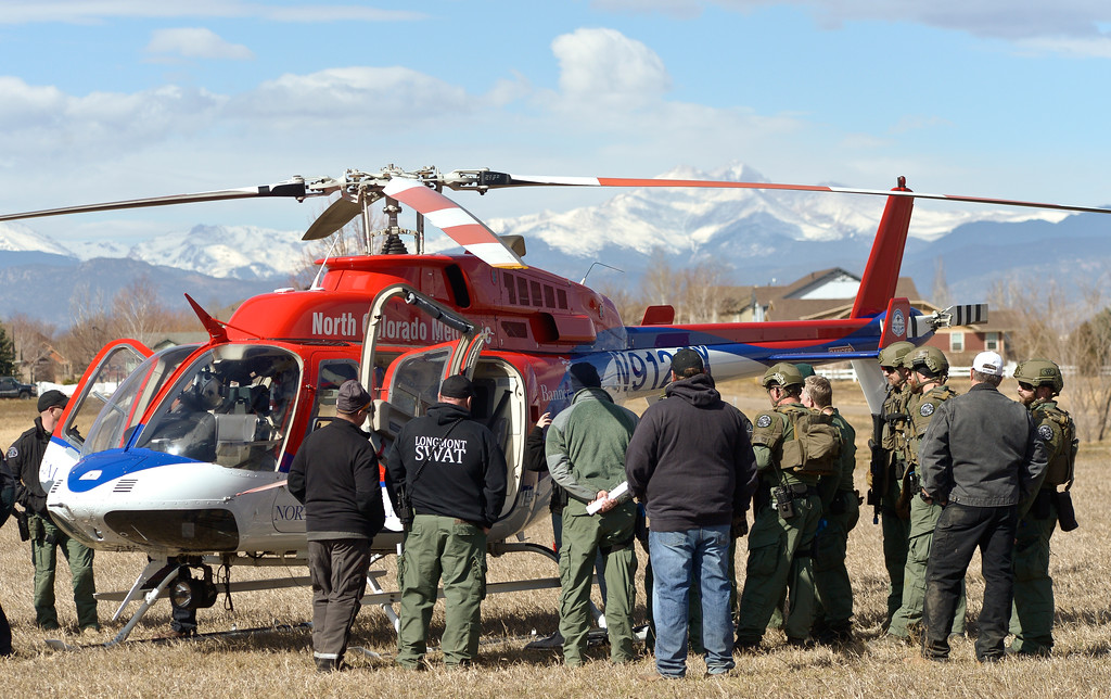 . SWAT team members gather around a North Colorado Med Evac helicopter during a Longmont Police Department SWAT training exercise in a field at Alpine Street and Colo. 66. To view more photos and a video visit timescall.com. Lewis Geyer/Staff Photographer March 12, 2018