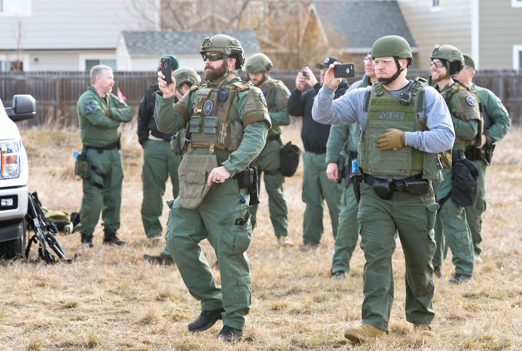 . SWAT team members watch a North Colorado Med Evac helicopter land during a Longmont Police Department SWAT training exercise in a field at Alpine Street and Colo. 66. To view more photos and a video visit timescall.com. Lewis Geyer/Staff Photographer March 12, 2018