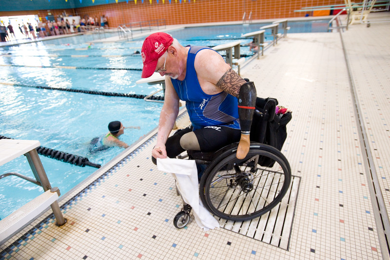 "Dennis Gordon settles into his wheelchair after completing the swimming portion of the Longmont Triathlon at Centennial Pool in Longmont on Sunday.<br /> More photos:  <a href=""http://www.dailycamera.com"">http://www.dailycamera.com</a><br /> (Autumn Parry/Staff Photographer)<br /> June 5, 2016"