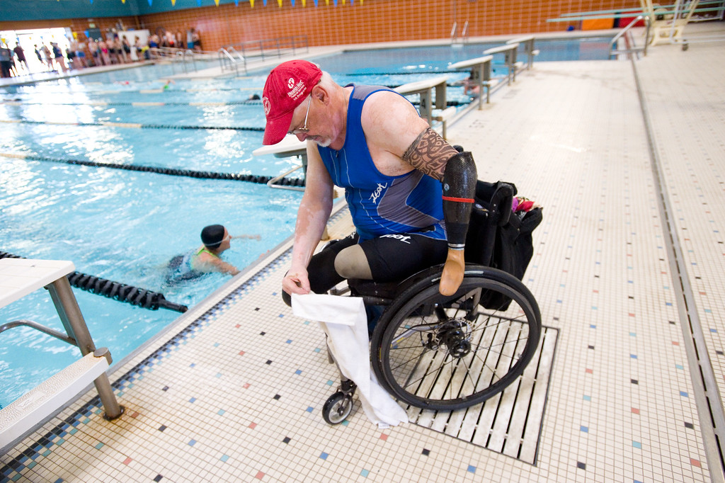 . Dennis Gordon settles into his wheelchair after completing the swimming portion of the Longmont Triathlon at Centennial Pool in Longmont on Sunday. More photos: www.dailycamera.com (Autumn Parry/Staff Photographer) June 5, 2016