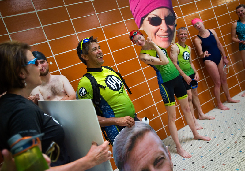 """Nicole Chandonnet holds up a picture of herself that was made by a supporter, as she waits in line to compete in the swimming portion of the Longmont Triathlon at Centennial Pool in Longmont on Sunday.<br /> More photos:  <a href=""""http://www.dailycamera.com"""">http://www.dailycamera.com</a><br /> (Autumn Parry/Staff Photographer)<br /> June 5, 2016"""