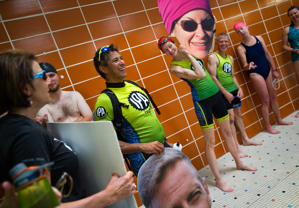 . Nicole Chandonnet holds up a picture of herself that was made by a supporter, as she waits in line to compete in the swimming portion of the Longmont Triathlon at Centennial Pool in Longmont on Sunday. More photos: www.dailycamera.com (Autumn Parry/Staff Photographer) June 5, 2016