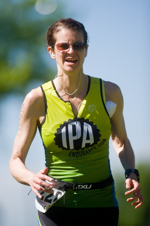"Nicole Chandonnet competes in the running portion of the Longmont Triathlon near Centennial Pool in Longmont on Sunday.<br /> More photos:  <a href=""http://www.dailycamera.com"">http://www.dailycamera.com</a><br /> (Autumn Parry/Staff Photographer)<br /> June 5, 2016"
