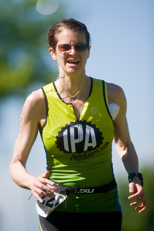 . Nicole Chandonnet competes in the running portion of the Longmont Triathlon near Centennial Pool in Longmont on Sunday. More photos: www.dailycamera.com (Autumn Parry/Staff Photographer) June 5, 2016