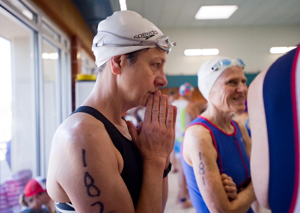 . Ann Wilson watches the swimmers compete in the wave before her, during the Longmont Triathlon at Centennial Pool in Longmont on Sunday. More photos: www.dailycamera.com (Autumn Parry/Staff Photographer) June 5, 2016