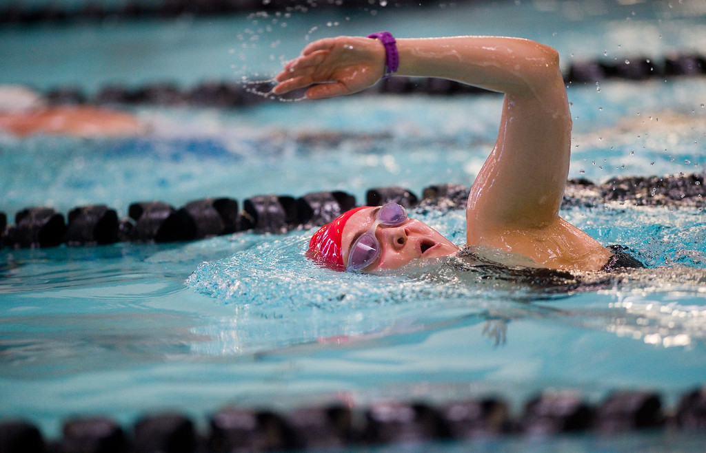 . Kate Smith competes in the swimming portion of the Longmont Triathlon at Centennial Pool in Longmont on Sunday. More photos: www.dailycamera.com (Autumn Parry/Staff Photographer) June 5, 2016
