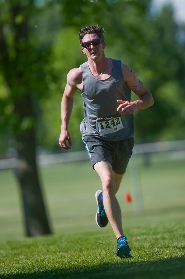 "Brahn Shinkle nears the finish line during the Longmont Triathlon near Centennial Pool in Longmont on Sunday.<br /> More photos:  <a href=""http://www.dailycamera.com"">http://www.dailycamera.com</a><br /> (Autumn Parry/Staff Photographer)<br /> June 5, 2016"