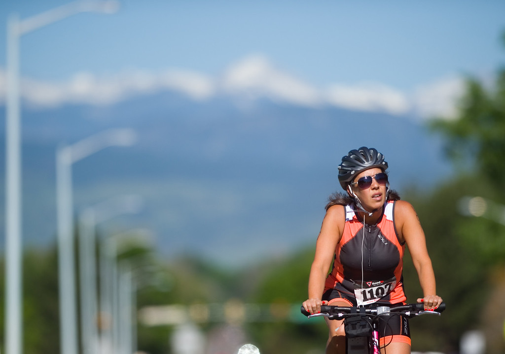 . Robin Green competes in the biking portion of the Longmont Triathlon near Centennial Pool in Longmont on Sunday. More photos: www.dailycamera.com (Autumn Parry/Staff Photographer) June 5, 2016