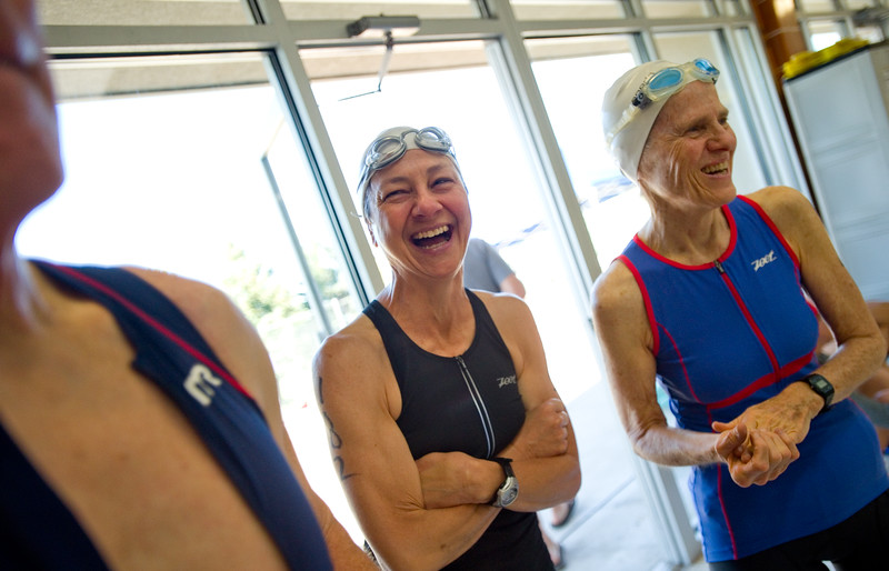 "Ann Wilson (left) and Brooke Alt share a laugh while waiting to compete in the swimming portion of the Longmont Triathlon at Centennial Pool in Longmont on Sunday.<br /> More photos:  <a href=""http://www.dailycamera.com"">http://www.dailycamera.com</a><br /> (Autumn Parry/Staff Photographer)<br /> June 5, 2016"