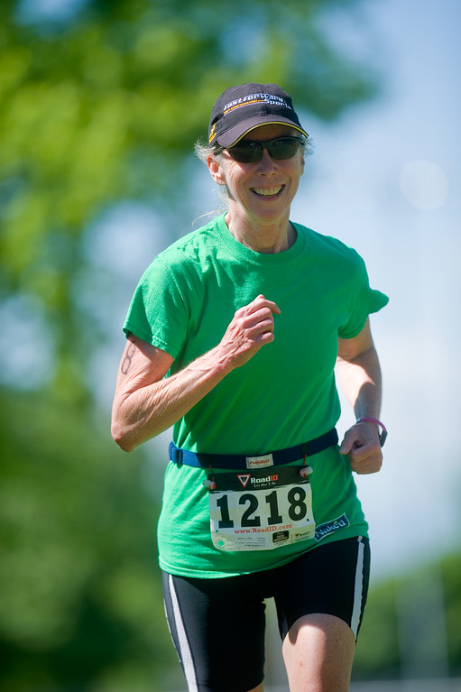 . Missy Carrier nears the finish line as she competes in the Longmont Triathlon near Centennial Pool in Longmont on Sunday. More photos: www.dailycamera.com (Autumn Parry/Staff Photographer) June 5, 2016