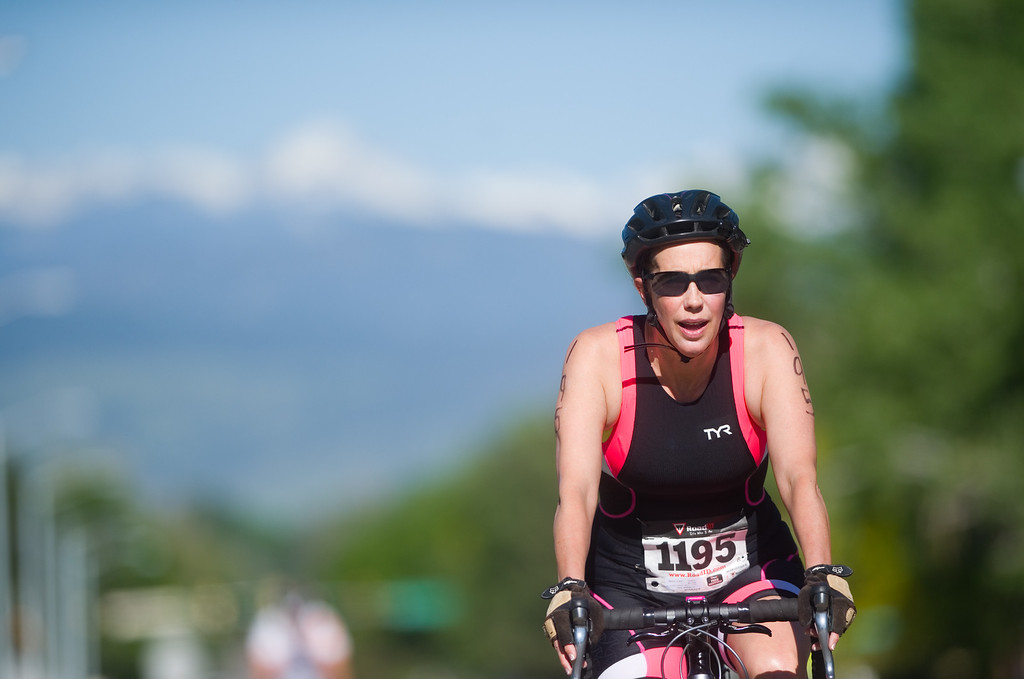 . Anne Kelson competes in the biking portion of the Longmont Triathlon near Centennial Pool in Longmont on Sunday. More photos: www.dailycamera.com (Autumn Parry/Staff Photographer) June 5, 2016