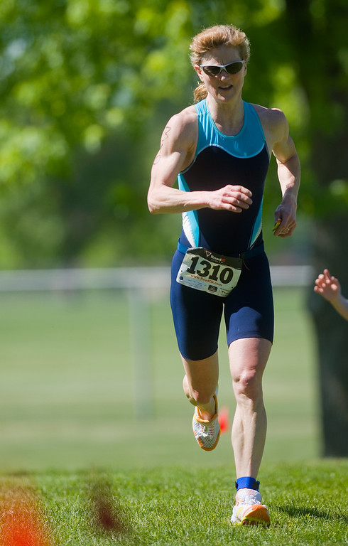 . Steph Popelar nears the finish line as she competes in the Longmont Triathlon near Centennial Pool in Longmont on Sunday. Popelar ranked first place overall for women, with a time of 01:03:59. More photos: www.dailycamera.com (Autumn Parry/Staff Photographer) June 5, 2016