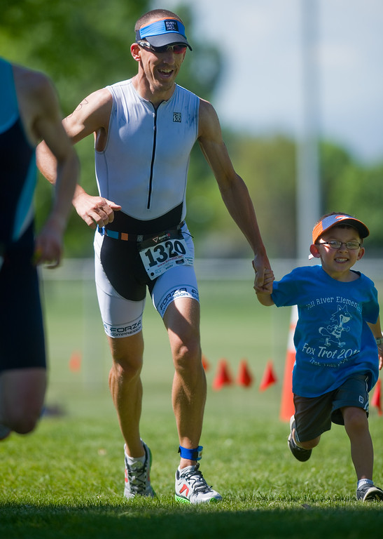 . Steve Johnson nears the finish line during the Longmont Triathlon near Centennial Pool in Longmont on Sunday. Johnson ranked first place overall for men, with a time of 56:48. More photos: www.dailycamera.com (Autumn Parry/Staff Photographer) June 5, 2016