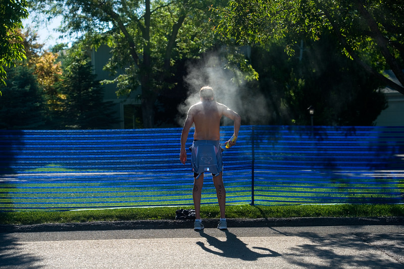 "A participant sprays himself with sunscreen before beginning the biking portion of the Longmont Triathlon at Centennial Pool in Longmont on Sunday.<br /> More photos:  <a href=""http://www.dailycamera.com"">http://www.dailycamera.com</a><br /> (Autumn Parry/Staff Photographer)<br /> June 5, 2016"