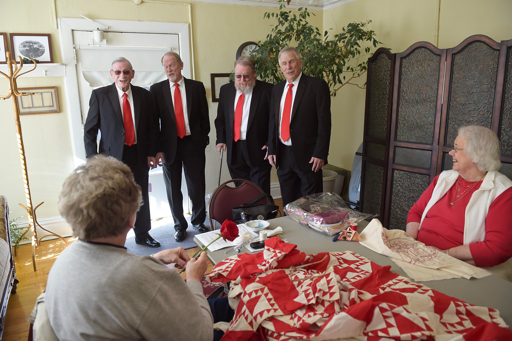 . From left: Longs Peak Chorus members David Waddell, Bill Niles, James Curts, and Rick Haines sing to David\'s wife Maryann, left, at the Callahan House Tuesday morning. To view a slideshow and video visit www.timescall.com. Lewis Geyer/Staff Photographer Feb. 14, 2017