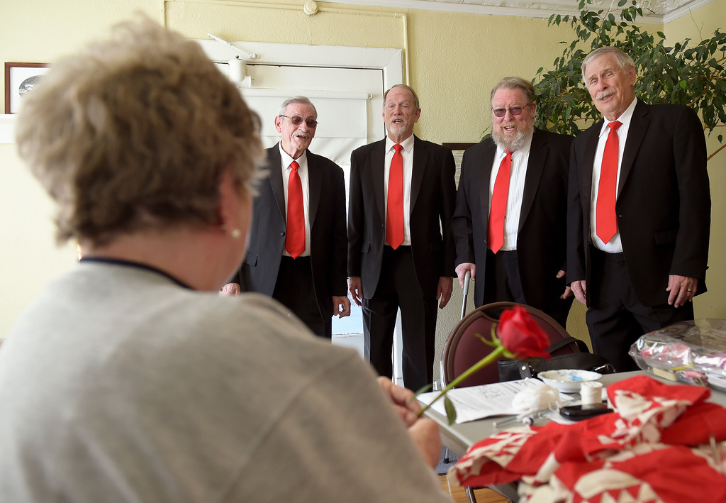 . From left: Maryann Waddell gets a Valentine\'s Day visit from members of the Longs Peak Chorus including her husband David Waddell, Bill Niles, James Curts, and Rick Haines at the Callahan House Tuesday morning. To view a slideshow and video visit www.timescall.com. Lewis Geyer/Staff Photographer Feb. 14, 2017