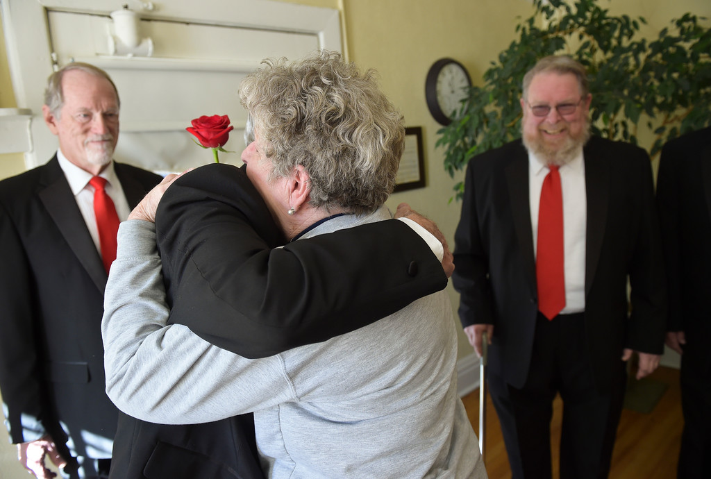 . Maryann Waddell hugs her husband David Waddell after he and other members of the Longs Peak Chorus surprised her with singing two Valentine\'s Day songs at the Callahan House Tuesday morning. To view a slideshow and video visit www.timescall.com. Lewis Geyer/Staff Photographer Feb. 14, 2017