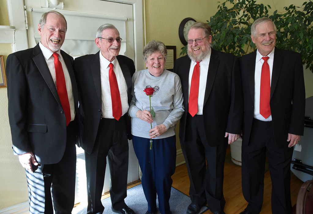 . From left: Bill Niles, David Waddell, David\'s wife Maryann Waddell, James Curts and Rick Haines, pose for a photo after the Longs Peak Chorus members sang to Maryann for Valentine\'s Day at the Callahan House Tuesday morning. To view a slideshow and video visit www.timescall.com. Lewis Geyer/Staff Photographer Feb. 14, 2017