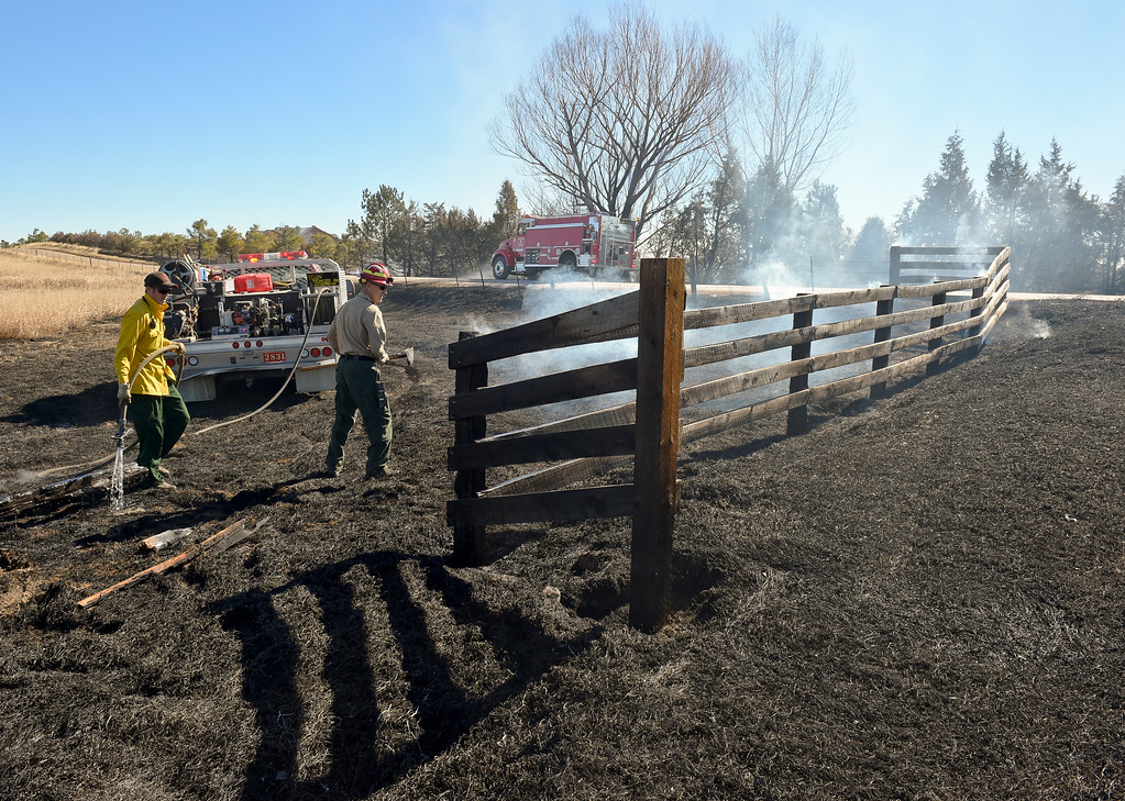 . A fence smolders at the scene 5-6 acre fire which started after a controlled burn got out of control Thursday morning in the 9000 block of Vermillion Road. Hygiene Fire was called at 11:18 a.m. and was assisted by Lyons Fire Department. To view a slideshow visit www.timescall.com. Lewis Geyer/Staff Photographer Feb. 16, 2017