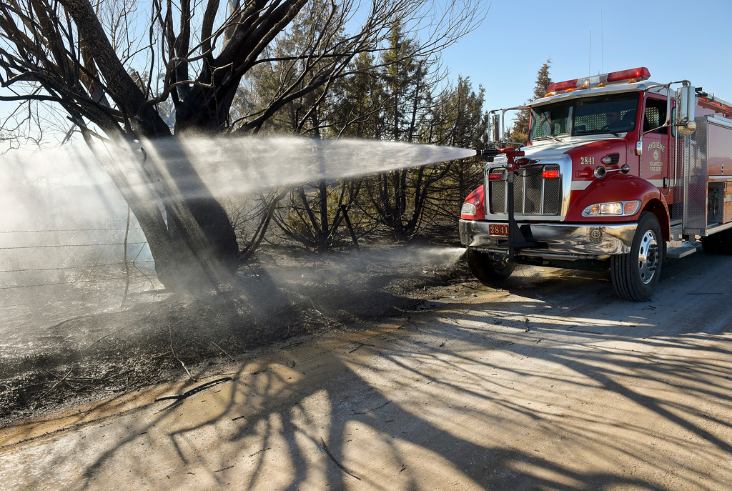 . A Hygiene fire truck douses hot spots on a tree at the scene 5-6 acre fire which started after a controlled burn got out of control Thursday morning in the 9000 block of Vermillion Road. Hygiene Fire was called at 11:18 a.m. and was assisted by Lyons Fire Department. To view a slideshow visit www.timescall.com. Lewis Geyer/Staff Photographer Feb. 16, 2017