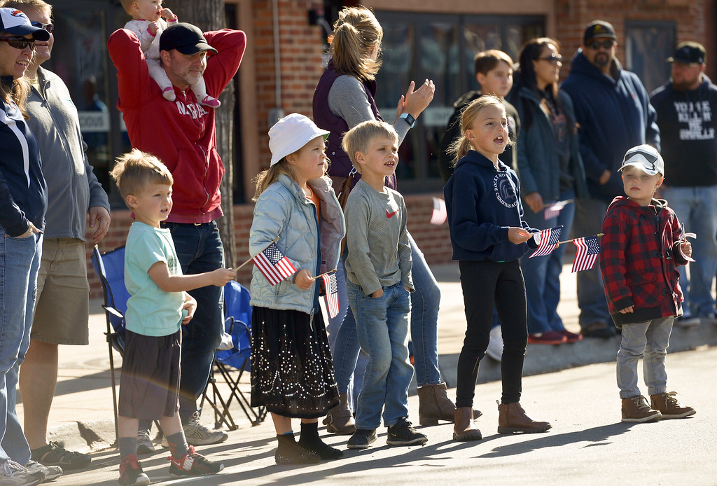 . LONGMONT, CO - NOVEMBER 10: From left: Jude Larrabee, 4, Helen Gifford, 6, Beaudin Larrabee, 6, Isabelle Pipp, 6, and Jack Pipp, 4, watch the Longmont Veterans Day parade on Main Street Nov. 10, 2018. (Photo by Lewis Geyer/Staff Photographer)