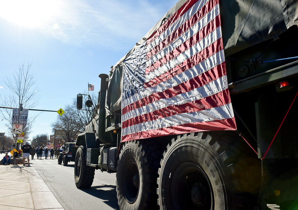 . LONGMONT, CO - NOVEMBER 10: A large U.S. flag adorns a military truck in the Longmont Veterans Day parade Nov. 10, 2018. (Photo by Lewis Geyer/Staff Photographer)