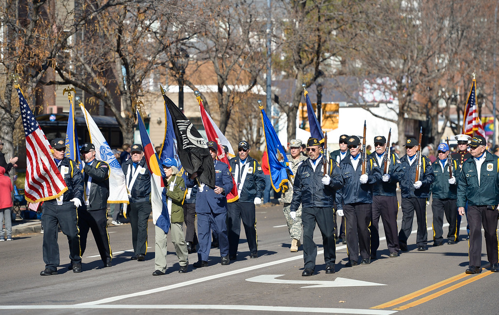 . LONGMONT, CO - NOVEMBER 10: Color guards lead the Longmont Veterans Day parade Nov. 10, 2018. (Photo by Lewis Geyer/Staff Photographer)