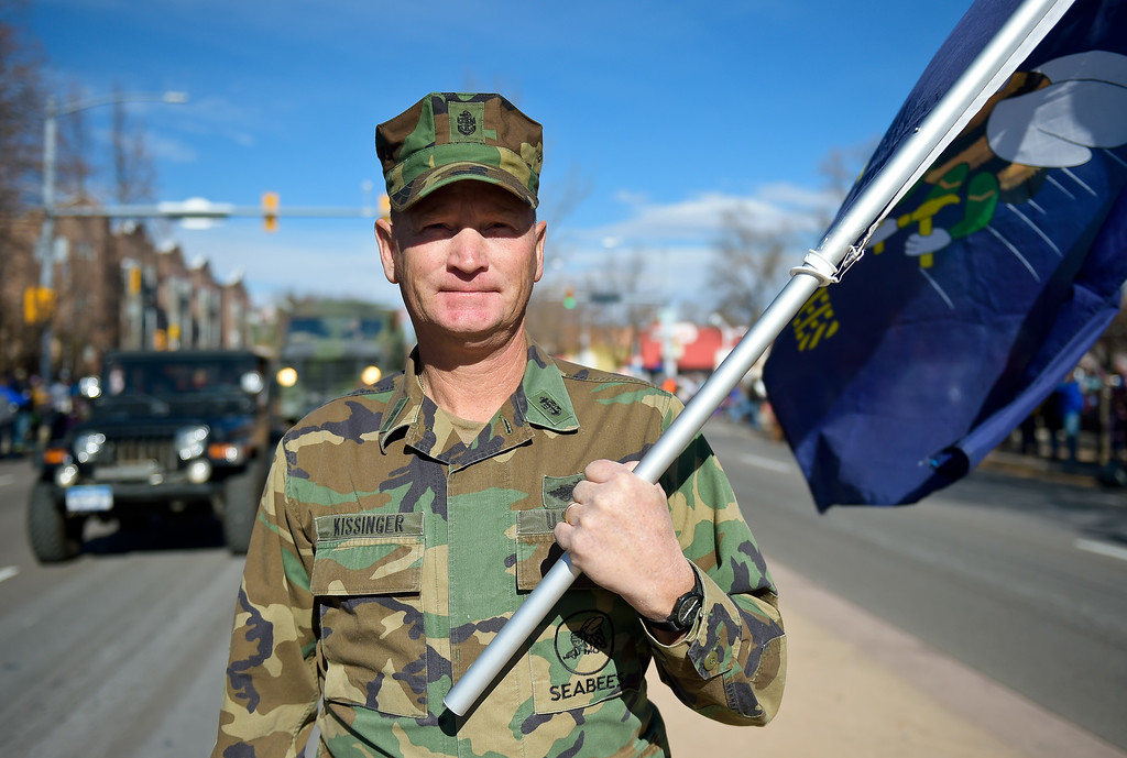 . LONGMONT, CO - NOVEMBER 10: Chief petty officer Gerald Kissinger carries the U.S. Navy Seabees flag in the Longmont Veterans Day parade Nov. 10, 2018. (Photo by Lewis Geyer/Staff Photographer)