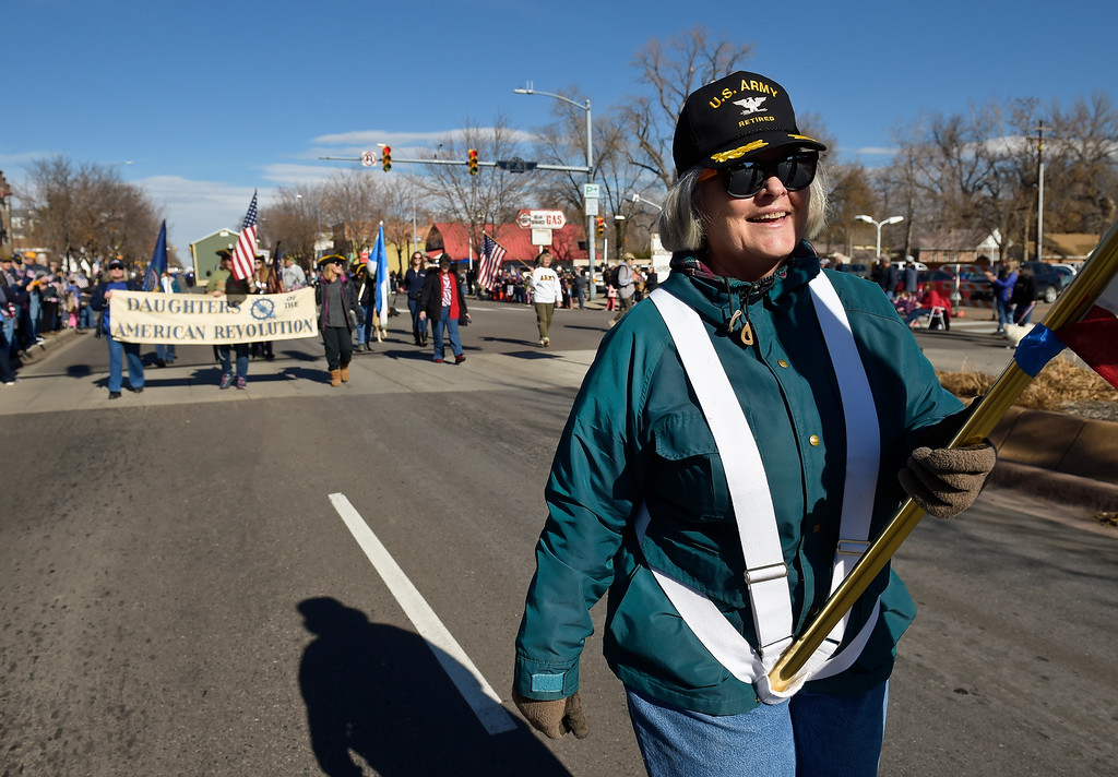 . LONGMONT, CO - NOVEMBER 10: Helen Aponte, with the Daughters of the American Revolution, carries the American Flag in the Veterans Day parade Nov. 10, 2018. (Photo by Lewis Geyer/Staff Photographer)