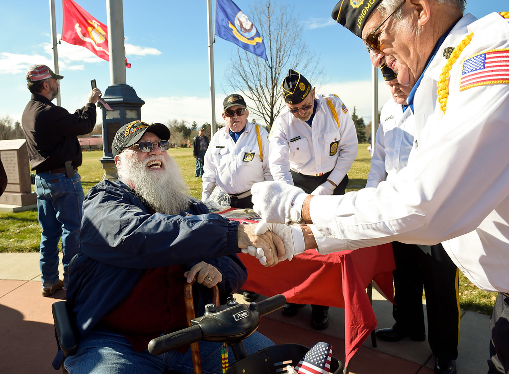 . LONGMONT, CO - NOVEMBER 10: Gary Jones receives his pin from Eugene Schiferl during the pinning ceremony for Vietnam Veterans as part of the Longmont Veterans Day celebration Nov. 10, 2018. (Photo by Lewis Geyer/Staff Photographer)