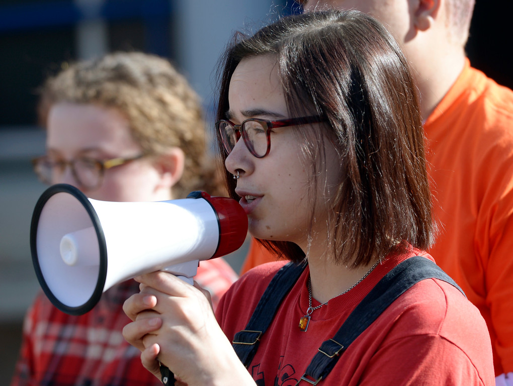 . Longmont High School senior Cyana Ruiz leads the protest Wednesday morning during National Walkout Day. To view more photos visit timescall.com. Lewis Geyer/Staff Photographer March 14, 2018