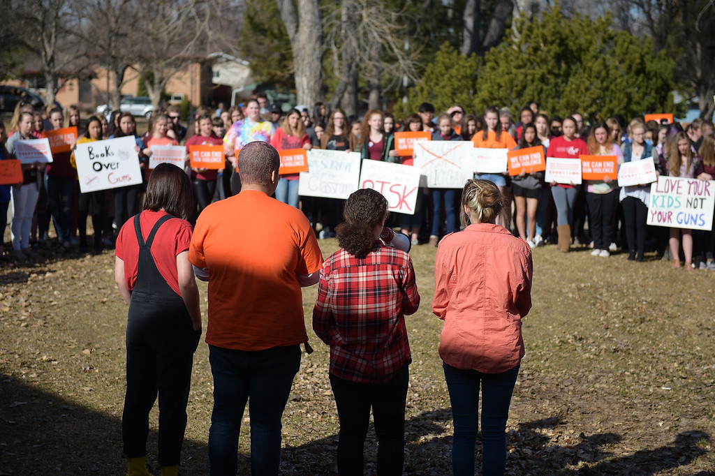 . Longmont High School gather outside the main entrance Wednesday morning during National Walkout Day. To view more photos visit timescall.com. Lewis Geyer/Staff Photographer March 14, 2018