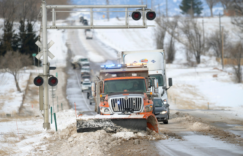 . MEAD, CO - MARCH 14:  A CDOT plow truck clears snow and ice from Colo. 66, approaching Weld County Road 5.5, March 14, 2019. Many stretches of the highway are still completely covered in ice and snow from Wednesday\'s blizzard. (Photo by Lewis Geyer/Staff Photographer)