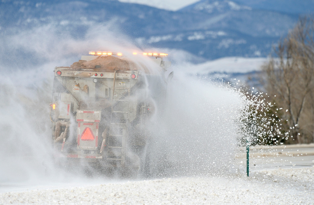 . LONGMONT, CO - MARCH 14:  A CDOT plow truck clears snow and ice from Colo. 66, on the north side of Longmont, March 14, 2019. Many stretches of the highway are still completely covered in ice and snow from Wednesday\'s blizzard. (Photo by Lewis Geyer/Staff Photographer)