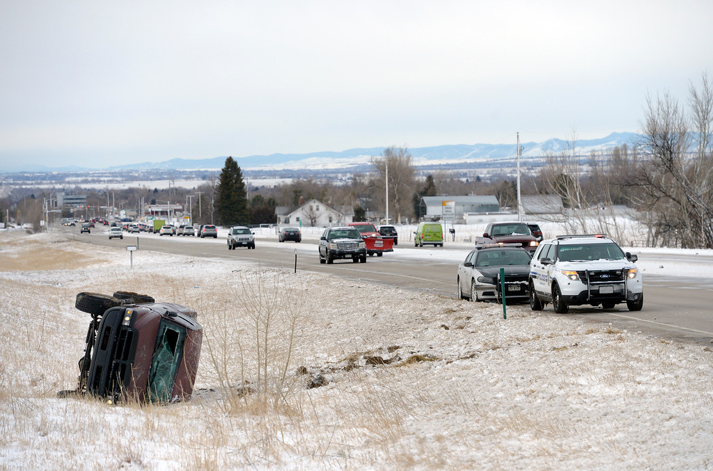 . LONGMONT, CO - MARCH 14:  A rolled pickup lays in a ditch along northbound U.S. 287, south of Vermillion Road, March 14, 2019. (Photo by Lewis Geyer/Staff Photographer)