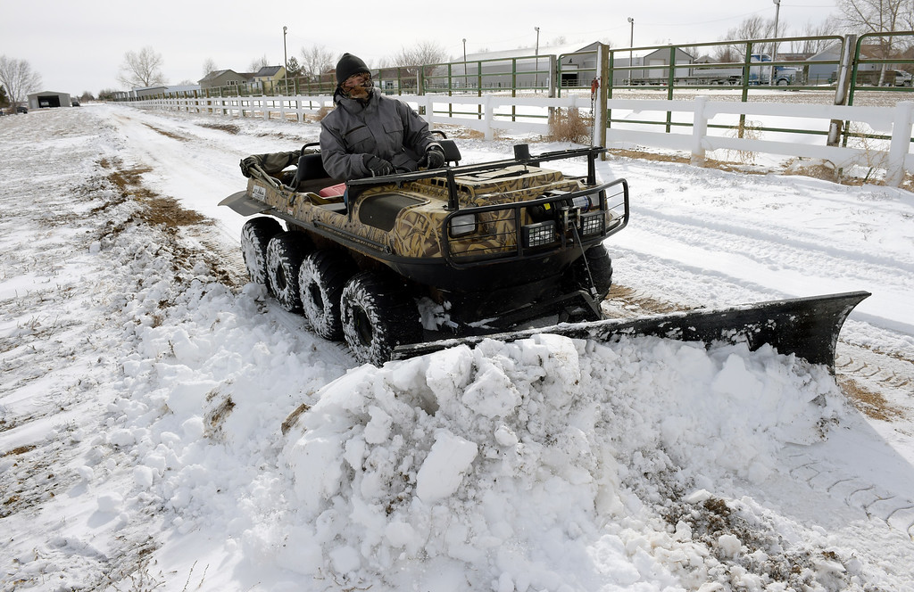 . FIRESTONE, CO - MARCH 14: Mike Marquardt uses his 1988 Argo eight-wheel-drive Argo ATV to clear the driveway in front of his home along Weld County Road 13 March 14, 2019. (Photo by Lewis Geyer/Staff Photographer)