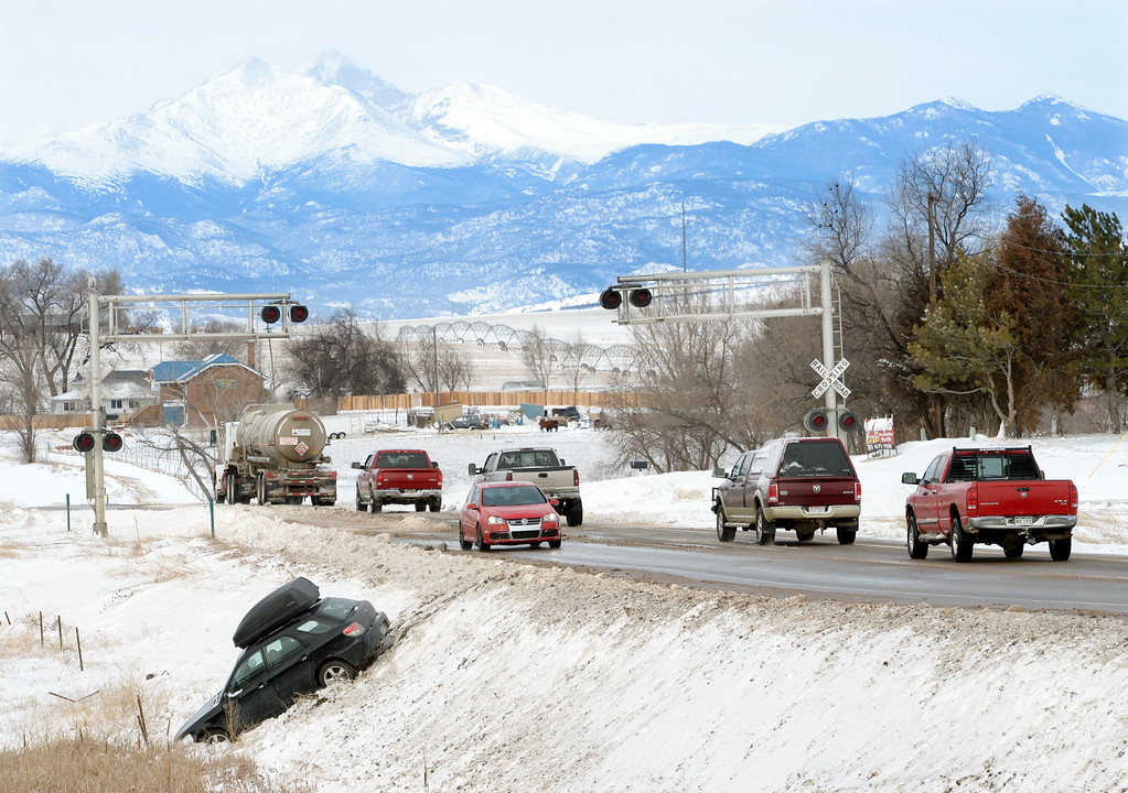 . MEAD, CO - MARCH 14: A car sits on an embankment along Colo. 66 March 14, 2019. The vehicle was one of several slide offs along Colo. between Longmont and I-25. (Photo by Lewis Geyer/Staff Photographer)