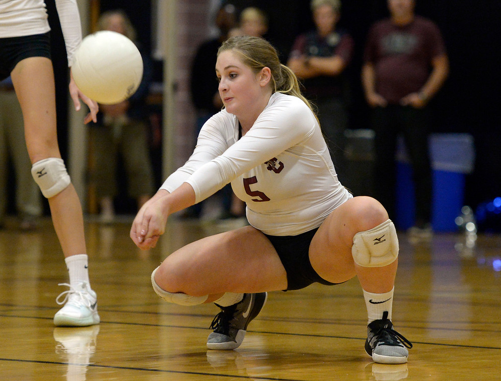 . Silver Creek\'s Jayla Harding touches first after a Longmont serve in the second game at Silver Creek High School Thursday night. To view more photos visit bocopreps.com. Lewis Geyer/Staff Photographer Oct. 19, 62017